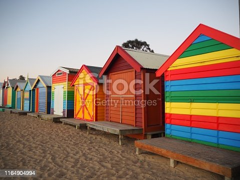 De identified beach huts in a row