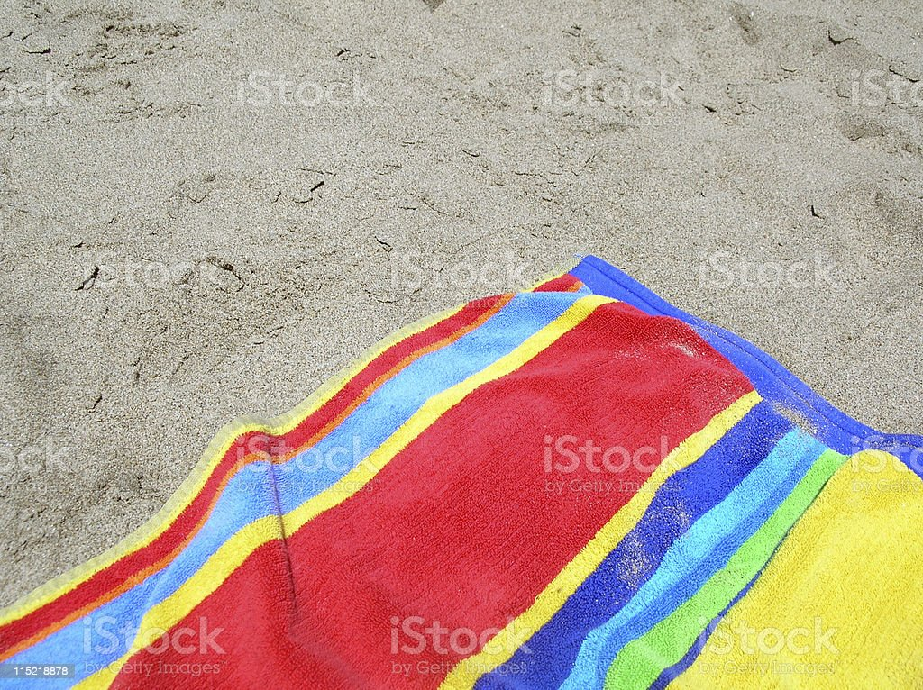 Bright beach towel stock photo