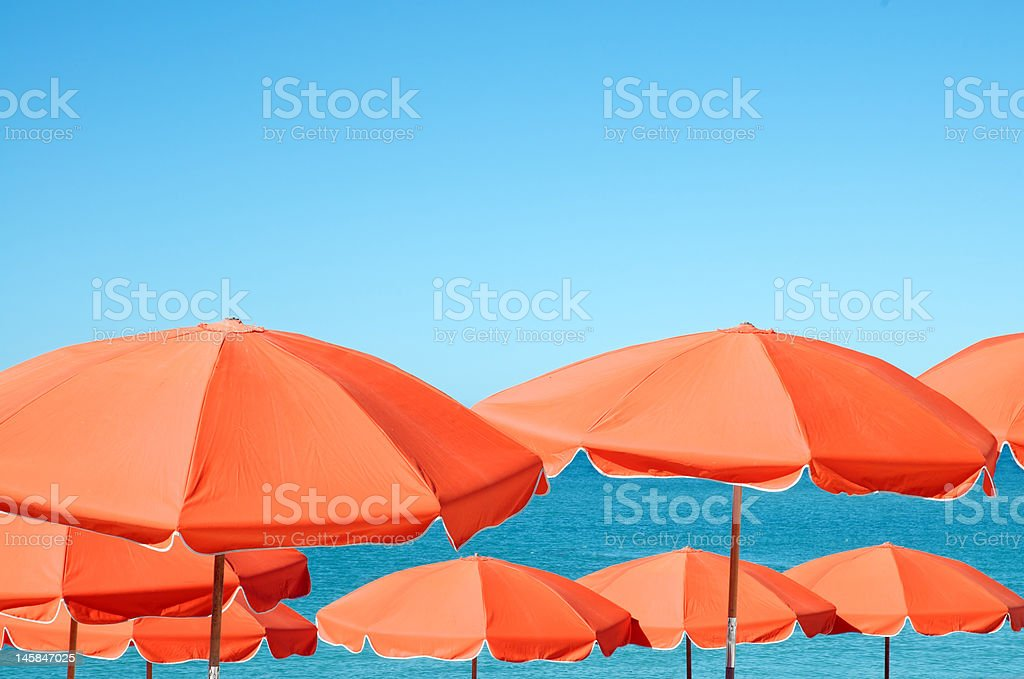 Bright beach umbrellas stock photo