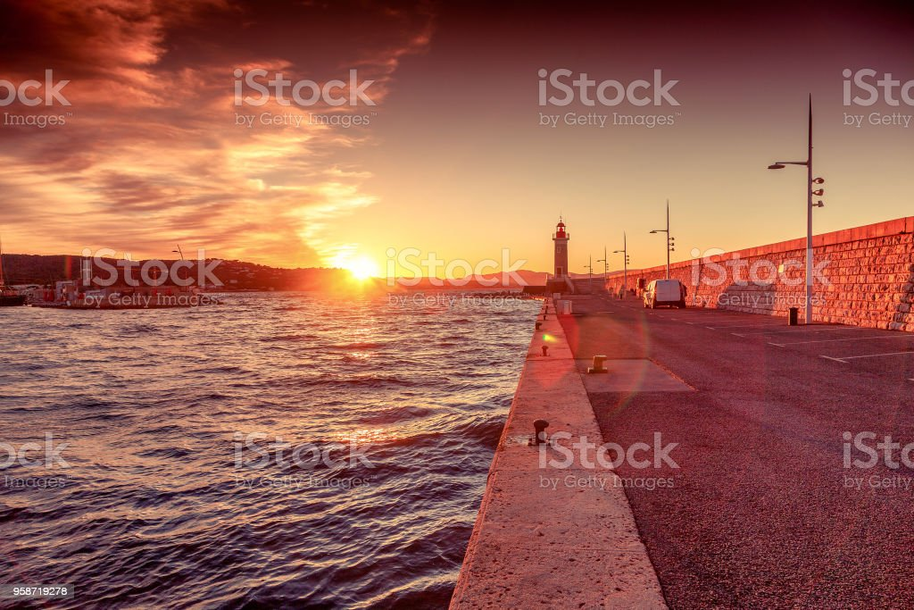 Bright beautiful colorful sunset, Lighthouse in Saint Tropez, France, Cote d Azur, Provence stock photo