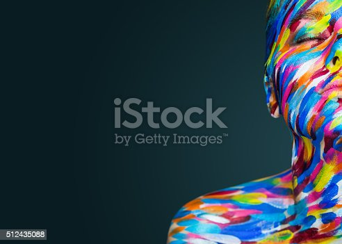istock Bright beautiful girl with art colorful make-up and bodyart 512435088