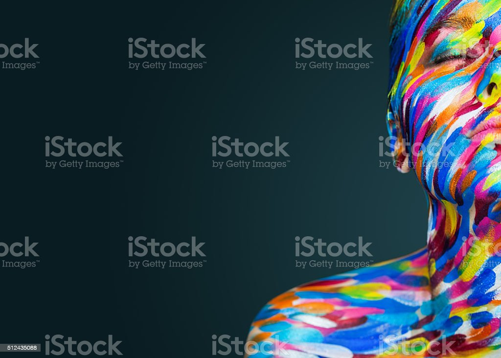 Bright beautiful girl with art colorful make-up and bodyart stock photo