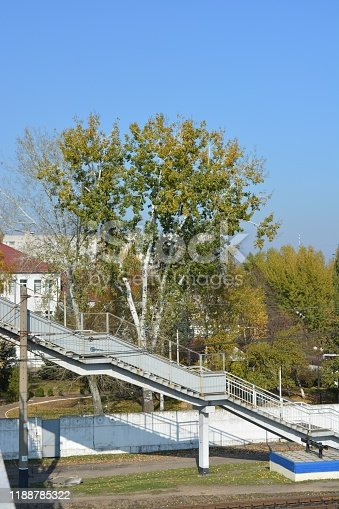 Bright autumn walk along the street and the area of the Northern housing estate, which is located near the Samara River, the city of Dnipro, Ukraine.