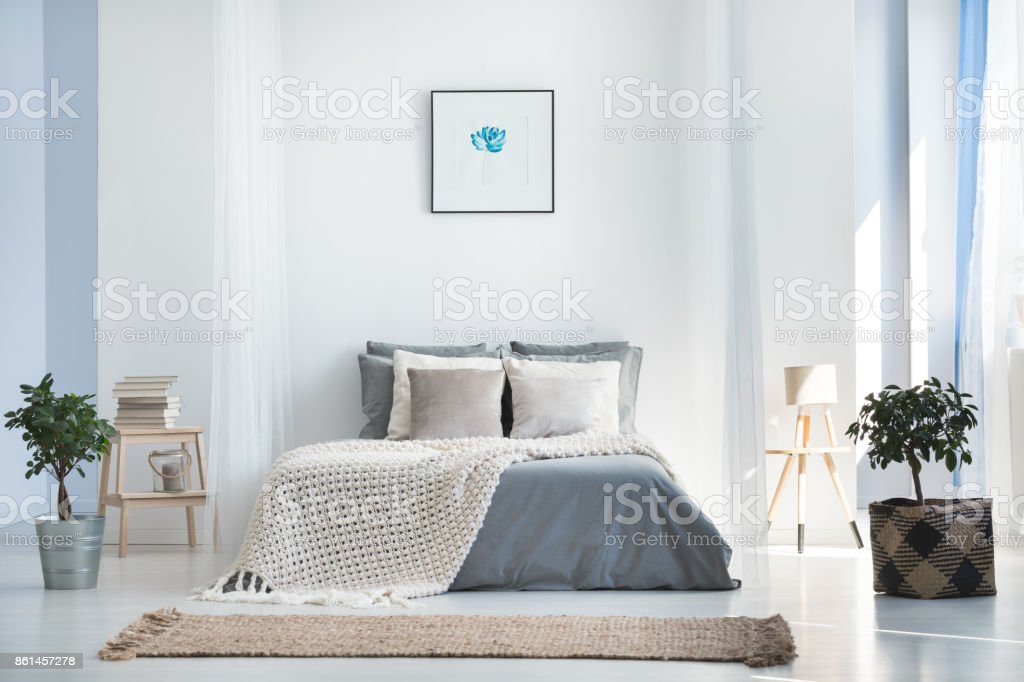 Bright bedroom interior with plants stock photo