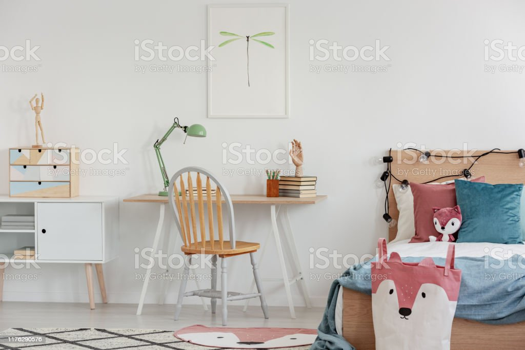 Bright Bedroom Interior With Single Bed With Turquoise Blanket On White Bedding And Colorful Pillows And Toy Stock Photo Download Image Now Istock