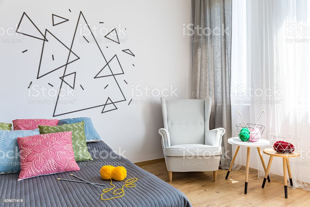Bright bedroom knitting wool and needles stock photo