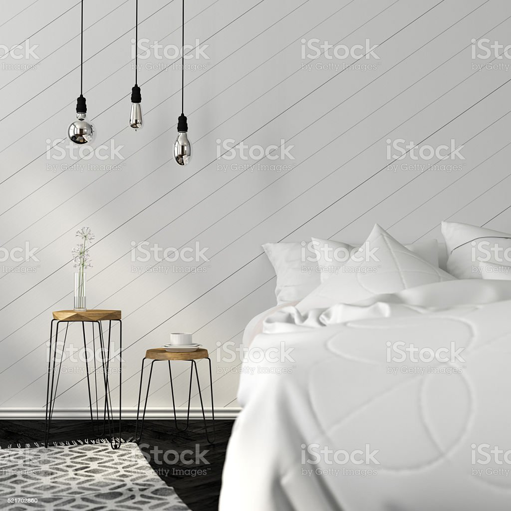 Bright bedroom with a stylish wooden stools stock photo