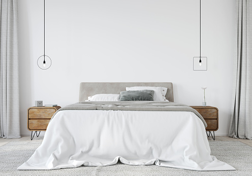 Bright Bedroom With A Wooden Bedside Table And A Stylish Chandeliers Stock Photo - Download Image Now