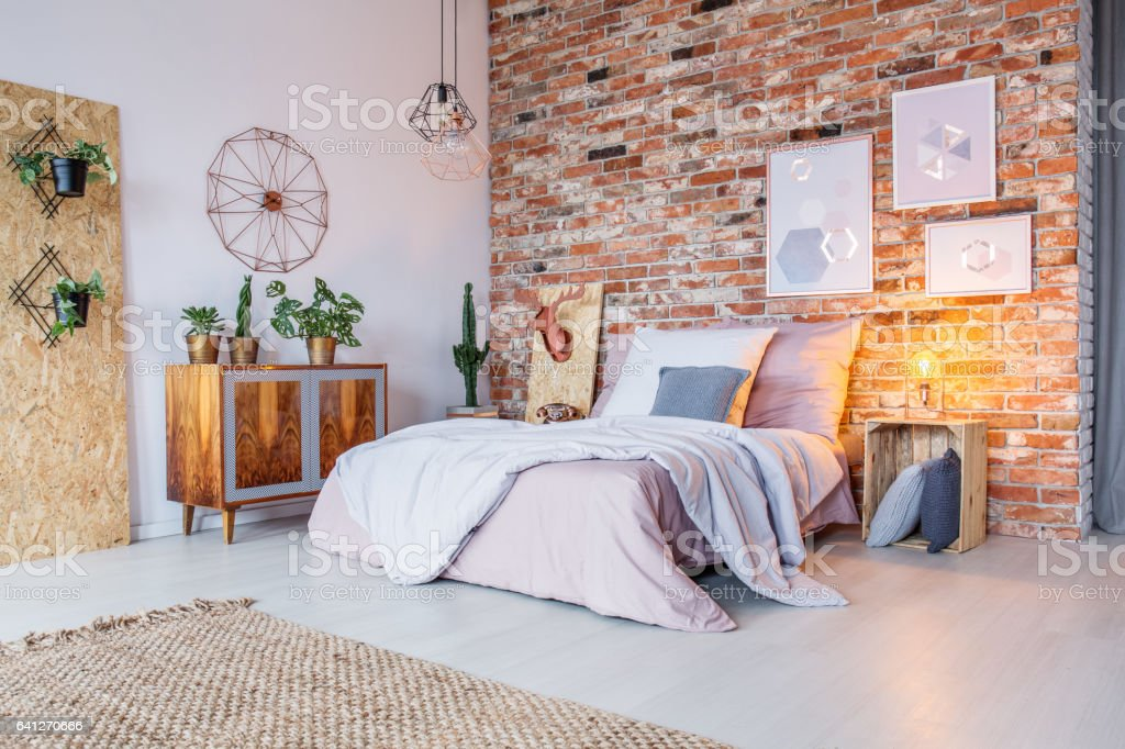 Bright bedroom with brick wall stock photo