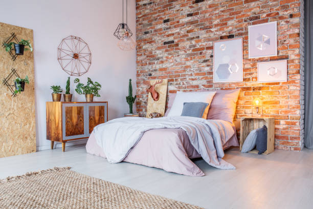 bright bedroom with brick wall - retro decor stock photos and pictures