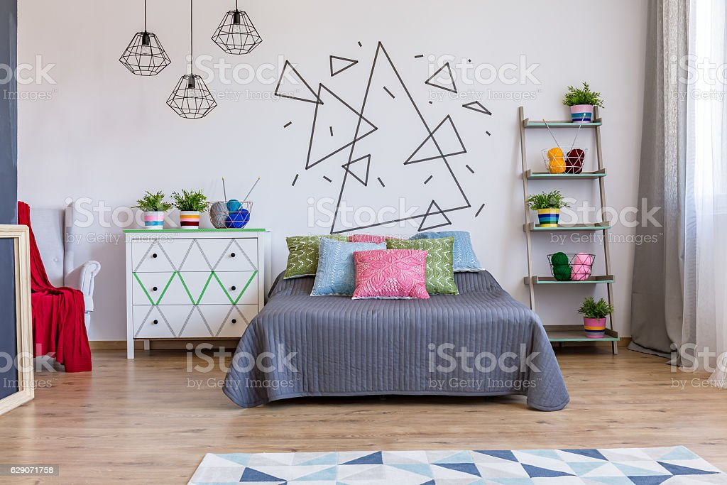 Bright bedroom with commode and bed stock photo