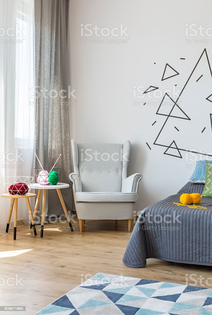 Bright bedroom with cosy armchair stock photo