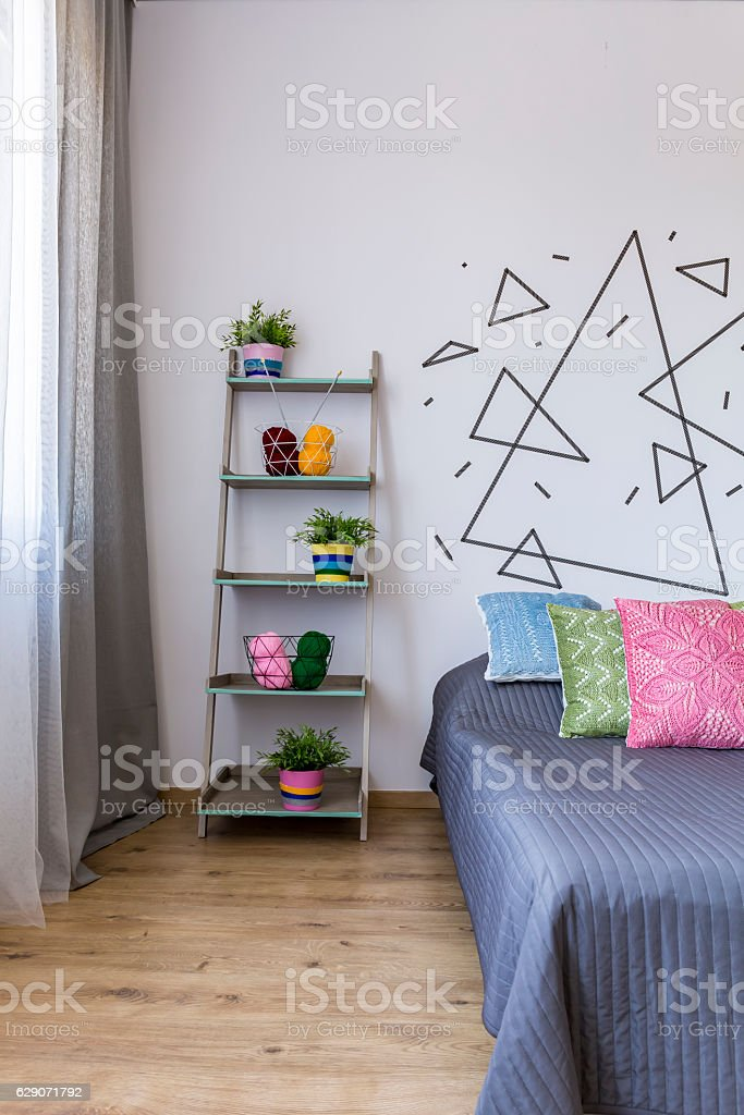 Bright bedroom with flower pots stock photo
