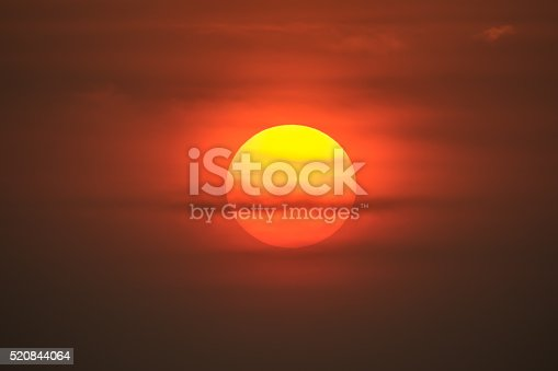 1013154212istockphoto Bright big sun on the sky with clouds 520844064
