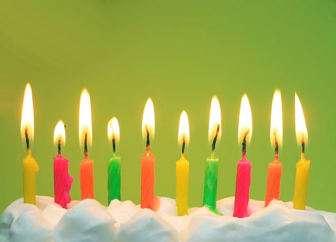 Bright Birthday Candles On Green Stock Photo - Download Image Now