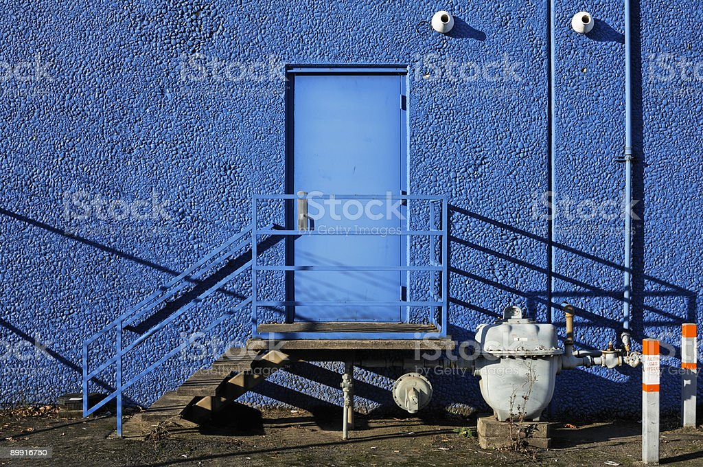 Bright blue Back Door Entrance - Employee only stock photo