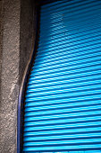 Bright blue corrugated iron sheets door close up for background