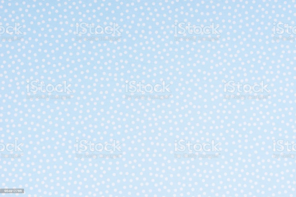 Bright blue paper with white spots and dots texture background. stock photo