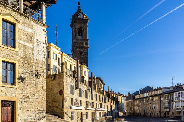 Bright blue sky over Vitoria Gasteiz historic center, with the tower bell of Church of San Vicente Martir. Vitoria Gasteiz, Basque Country, Spain, January 2019 stock photo