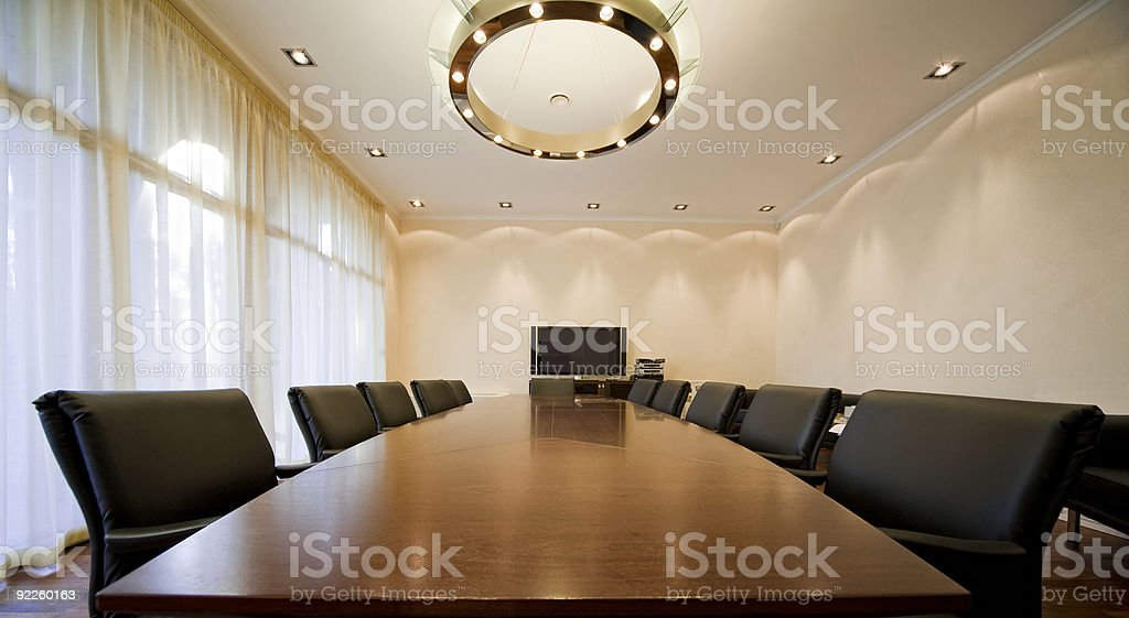 Bright boardroom with black office chairs stock photo