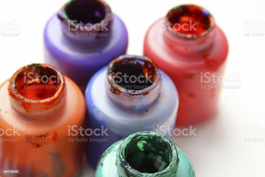 Bright Bottles of Poster Paints on white royalty-free stock photo