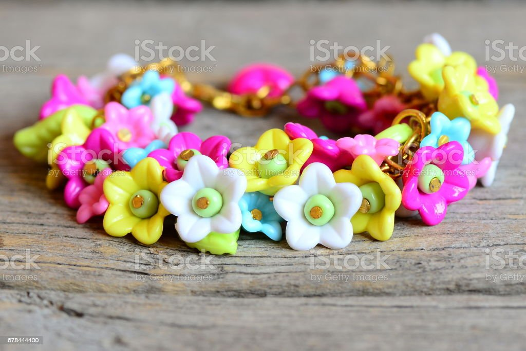 Bright bracelet isolated on old wooden background royalty-free stock photo