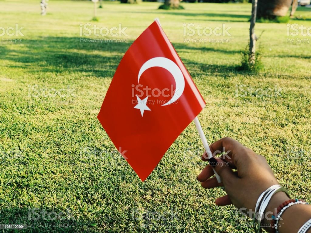 Bright capture of woman hand holding a Turkish flag stock photo