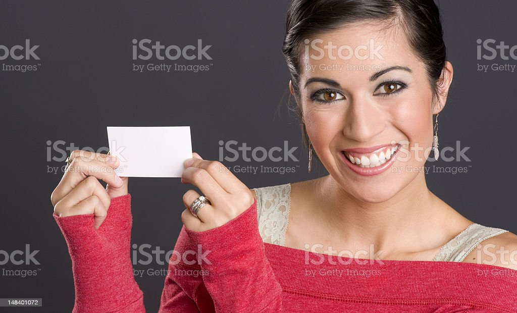 Bright Caucasian Woman in Red Showing Blank Business Card stock photo
