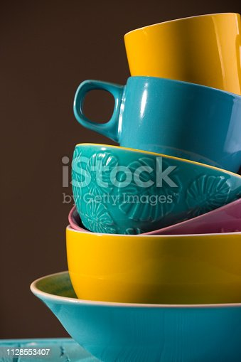 bright ceramics - cups and bowls in blue, yellow and pink colors