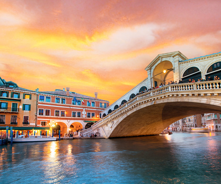 Bright charming landscape with  Rialto Bridge at sunset in Venice, Italy, Europe
