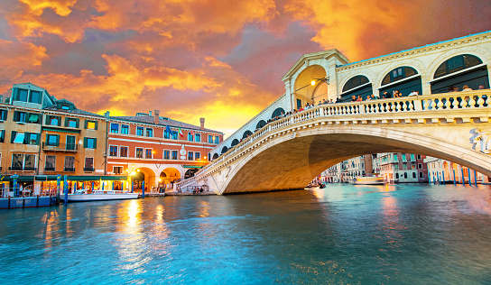 Bright charming panoramic landscape Rialto Bridge in Venice, Italy, Europe, at sunset