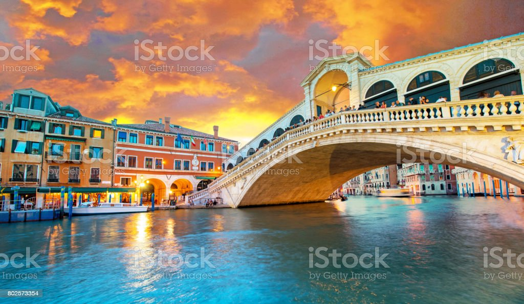 Bright charming panoramic landscape Rialto Bridge in Venice, Italy, Europe, at sunset stock photo