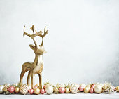 istock Bright Christmas Background with rose pink and gold decorations with gold reindeer on white wood 1271851227