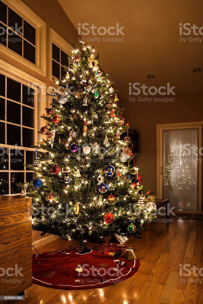 Bright Christmas Lights and Ornaments on Holiday Christmas Tree stock photo