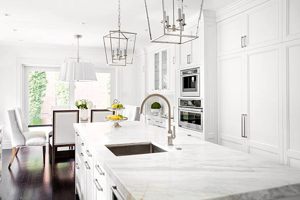 bright classic white kitchen - kitchen counter stock photos and pictures