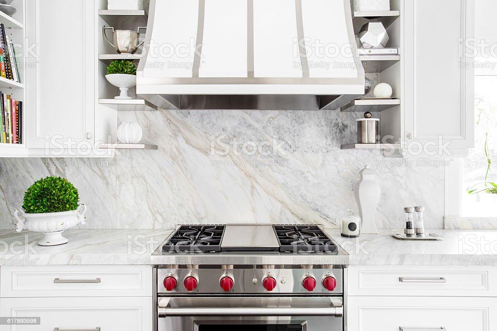 Bright Classic White kitchen with gas range stock photo