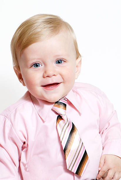 bright closeup portrait of adorable baby businessman stock photo