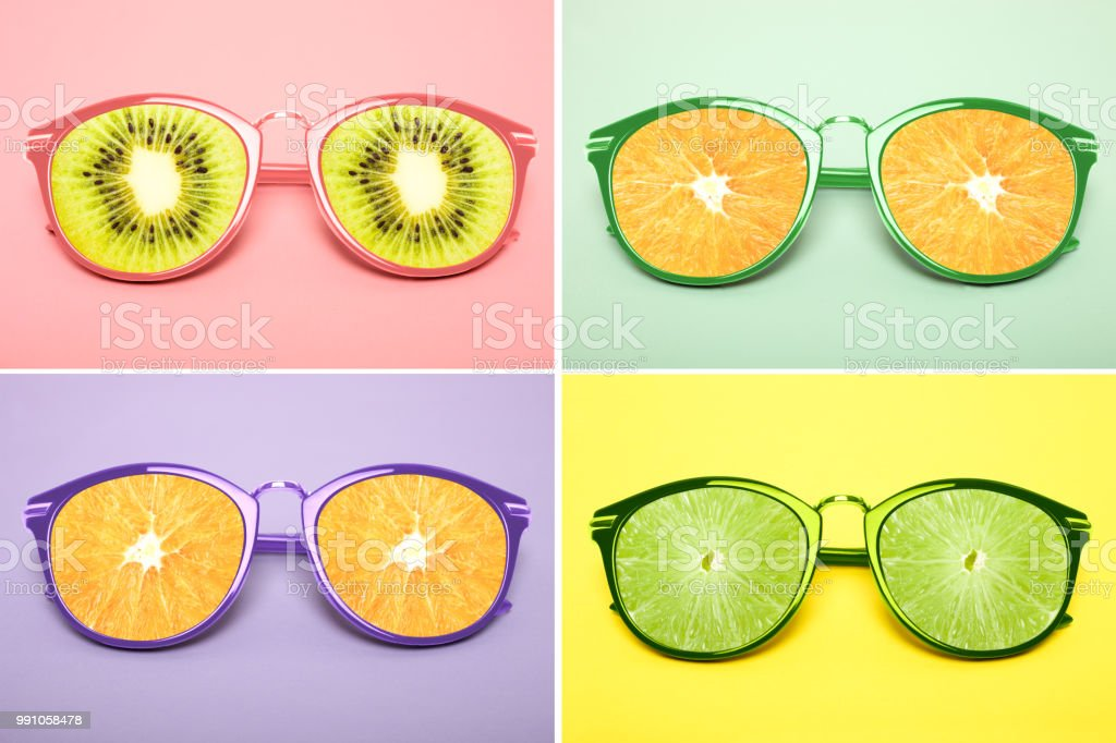 Bright collage of four sunglasses with citruses instead of glass stock photo