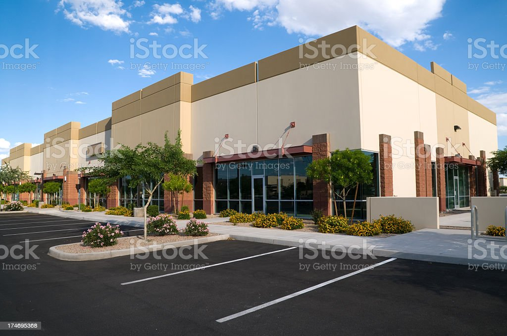 Bright colored photo of parking lot and office building stock photo