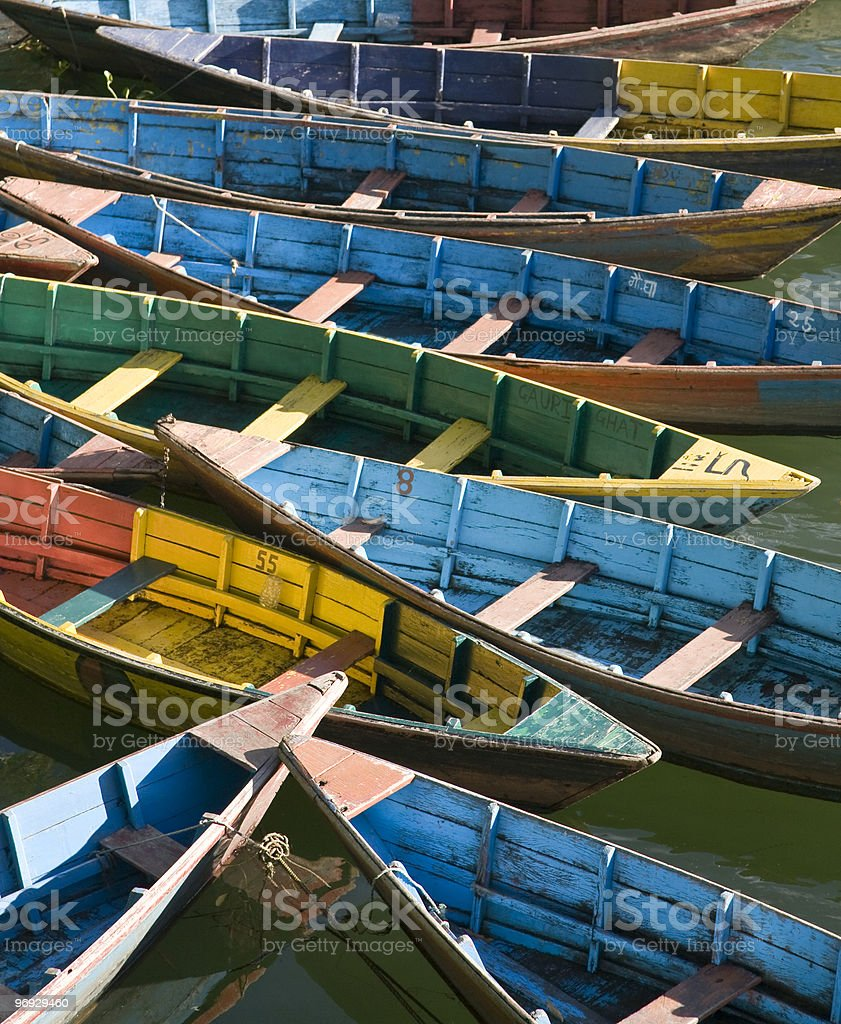 Bright colored wooden boats in Pokhara royalty-free stock photo