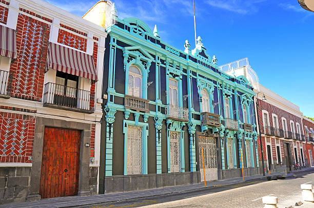 Bright Colorful Buildings in Puebla, Mexico Bright Colorful Buildings in Puebla, Mexico puebla state stock pictures, royalty-free photos & images