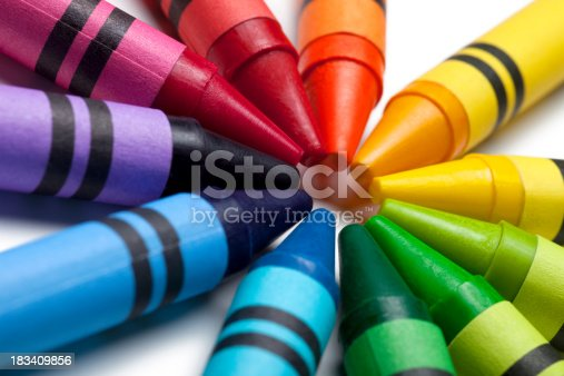 This is a close up photograph of colorful crayon tips pointing towards each other.Click on the links below to view lightboxes.