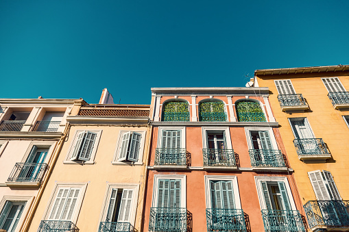 Bright Colorful Facades Of Ancient Buildings Provence Côte Dazur France Fréjus Typical French Architecture Shutters Carved Delicate Details Stock Photo - Download Image Now