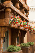 Bright Colorful Flowers in Hanging Baskets on a Wooden Cottage in Orlando, Florida