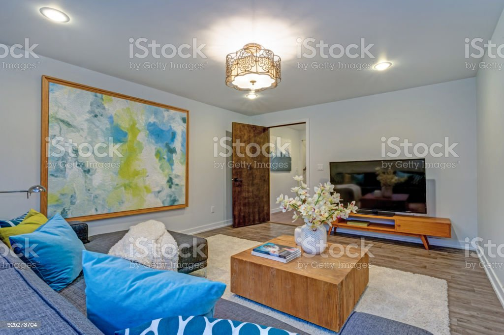 Bright colorful modern family room interior with wood accents. stock photo