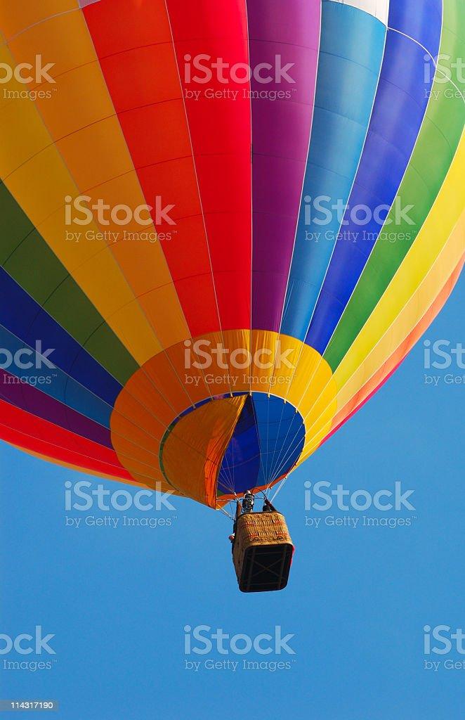 Bright colorful rainbow hot air balloon royalty-free stock photo