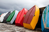 Bright colorful rowboats standing on a jetty
