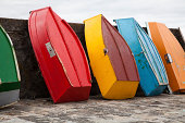 Bright colorful standing boats on a pier