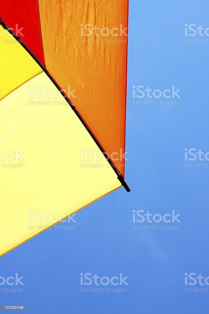 Bright Colorful Umbrella and Blue Sky stock photo