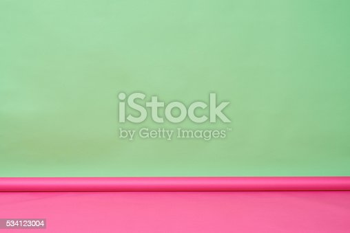Background of green wall and pink floor